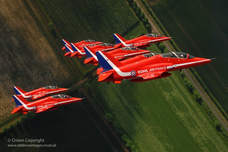 The Red Arrows are pictured as they fly in tight formation during display training