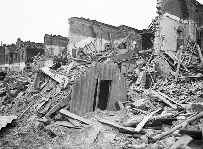 An Anderson shelter remains intact amidst destruction in Latham Street, Poplar, London during 1941. from the collections of the Imperial War Museums - Photograph D 5949
