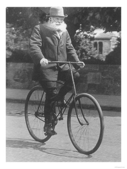 John Boyd Dunlop on his bicycle circa 1915 - Public domain